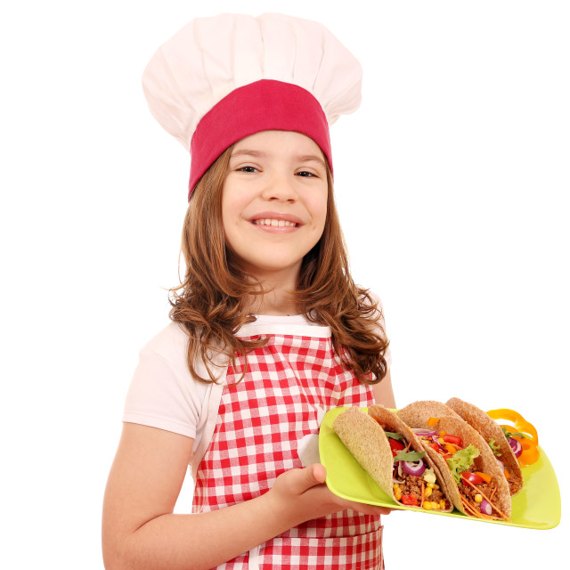 """Happy little girl cook with tacos on plate"" stock image"