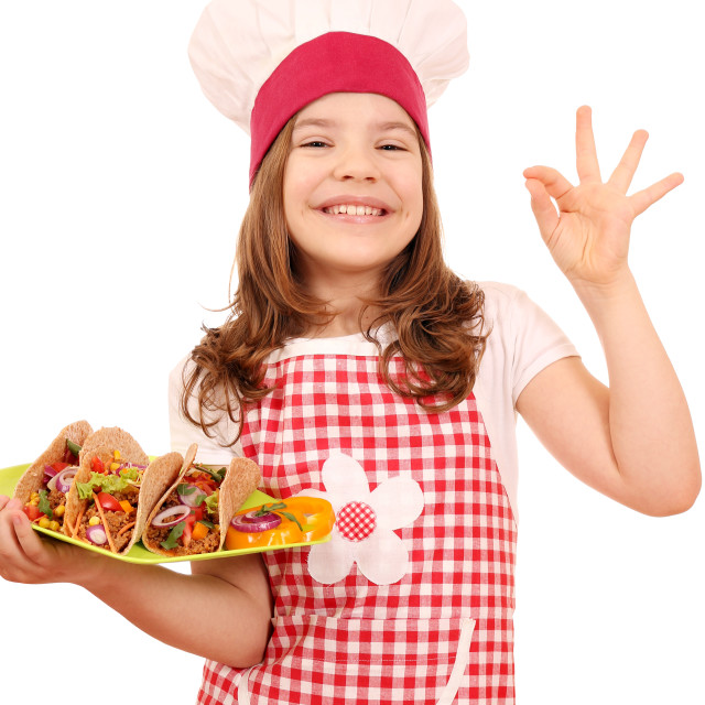 """happy little girl cook with tacos and ok hand sign"" stock image"