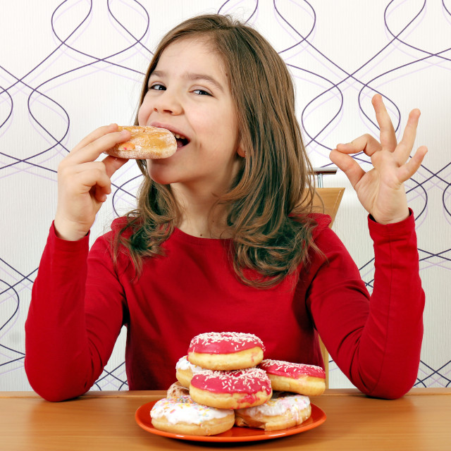 """hungry little girl eat sweet donuts"" stock image"
