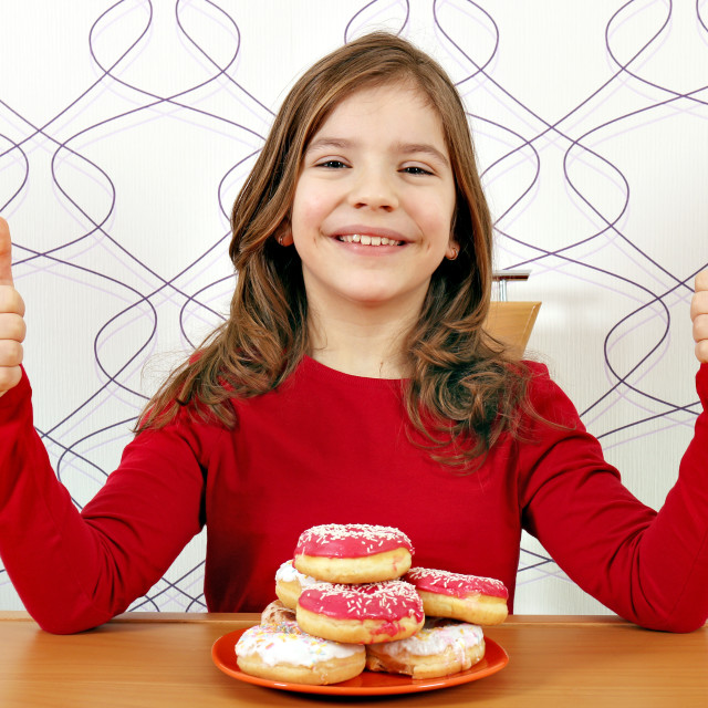 """happy little girl with donuts and thumbs up"" stock image"