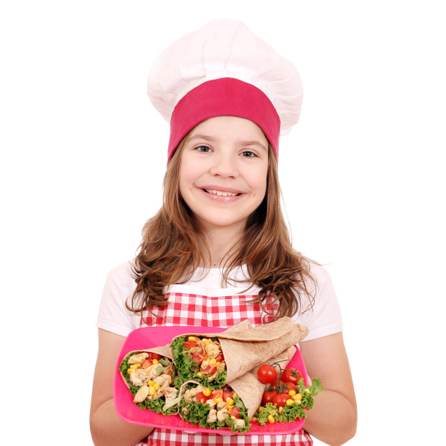 """Happy little girl cook with burritos"" stock image"