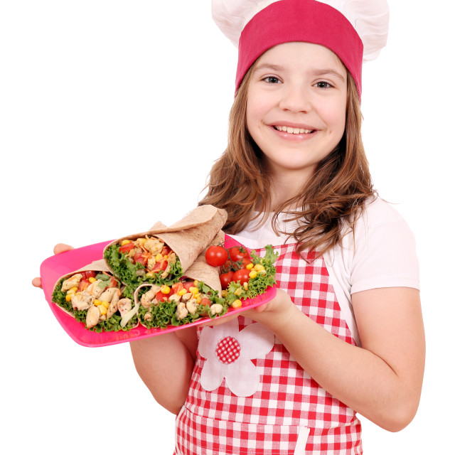 """happy little girl cook with burritos on plate"" stock image"