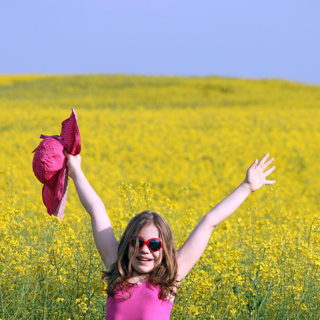 """happy little girl on yellow flowers field summer season"" stock image"