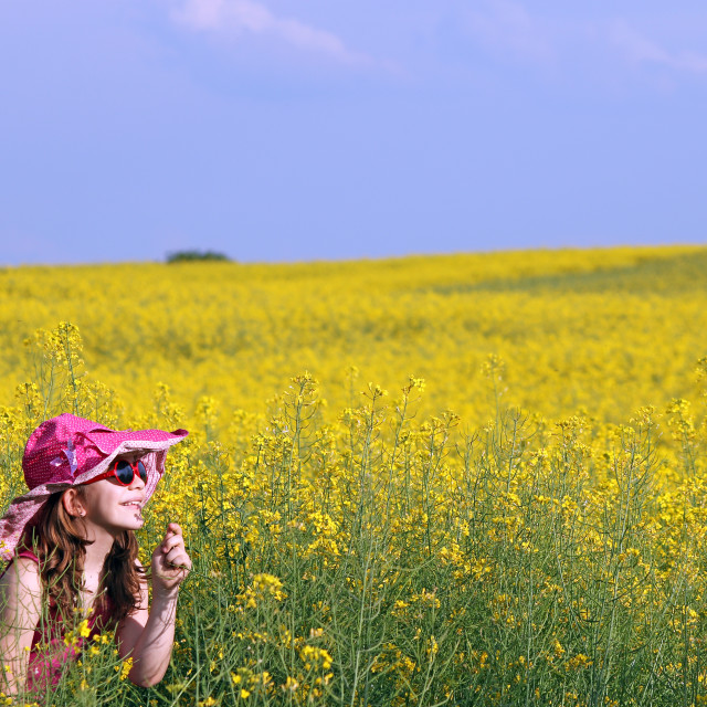 """happy little girl on yellow flowers field"" stock image"
