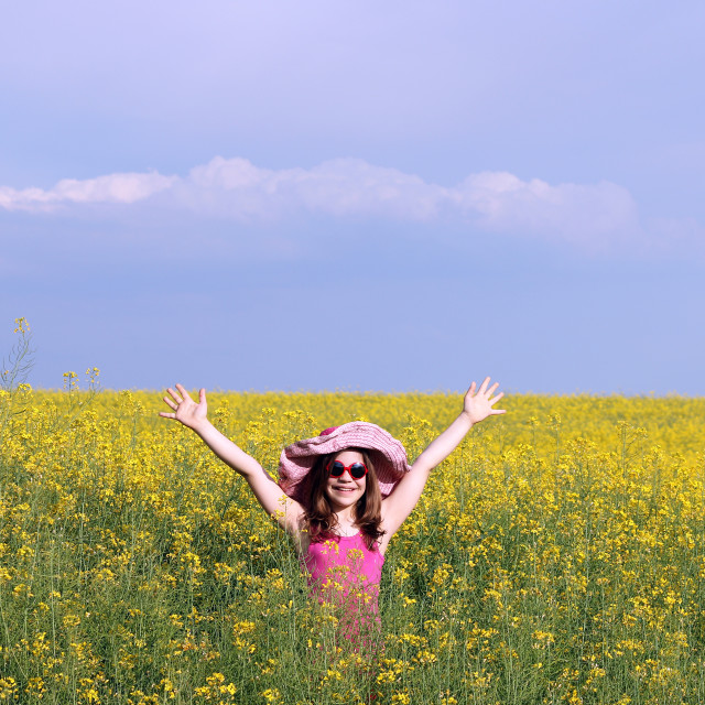 """happy little girl on field summer season"" stock image"