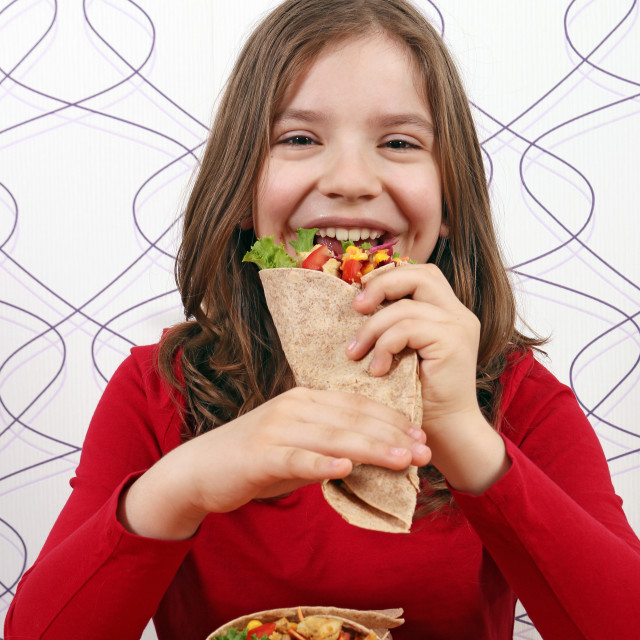 """hungry little girl eat burritos"" stock image"