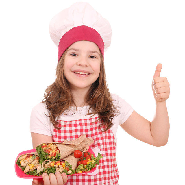 """Happy little girl cook with burritos and thumb up"" stock image"