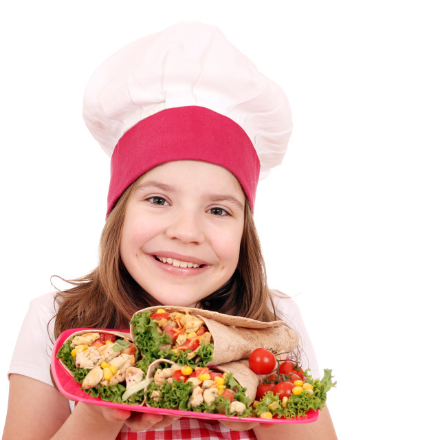 """Happy little girl cook with burritos fast food"" stock image"