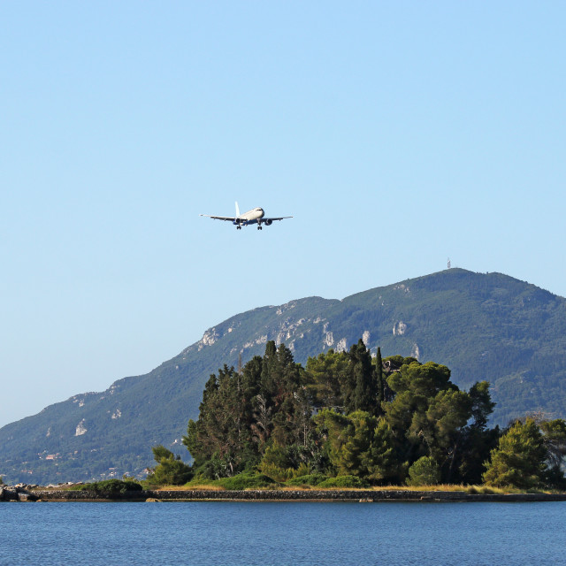 """airplane flying over Mouse island Corfu Greece"" stock image"