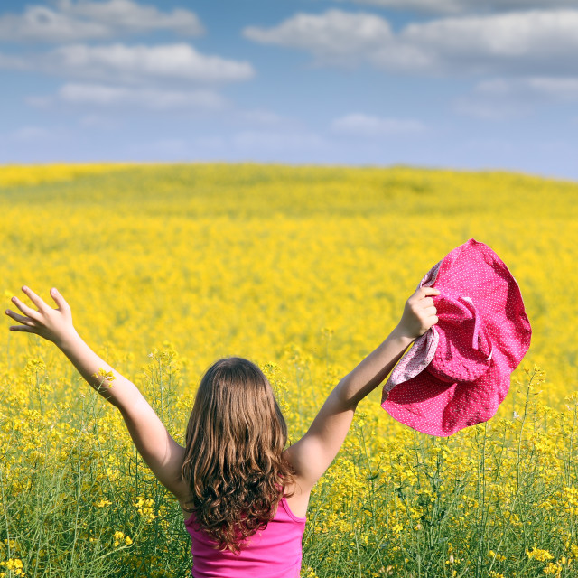 """little girl with hands up on field"" stock image"