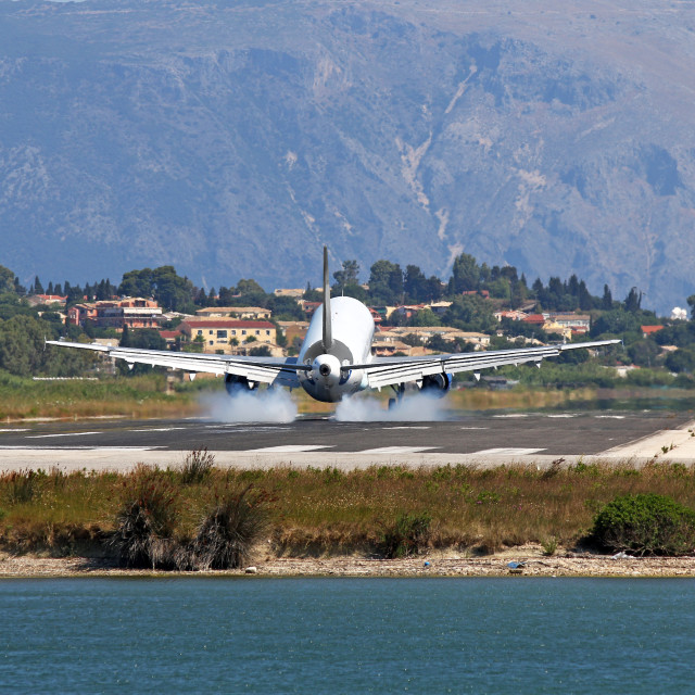 """passenger airplane landing on Corfu airport"" stock image"