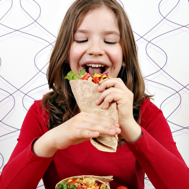 """little girl eat burritos fast food"" stock image"
