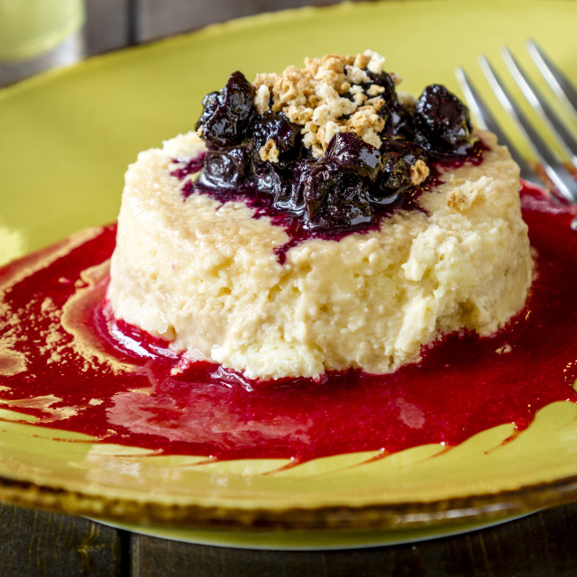 """""""Cheesecake topped with blueberries and raspberry sauce"""" stock image"""