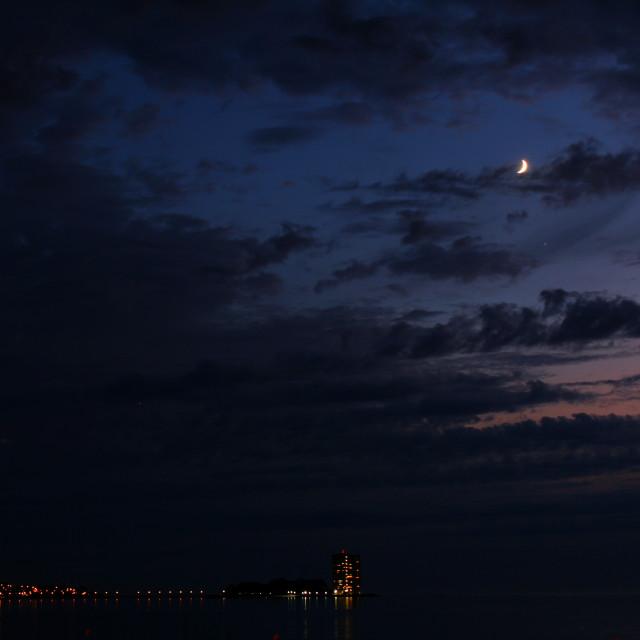 """Toralla Island under the moon sky"" stock image"