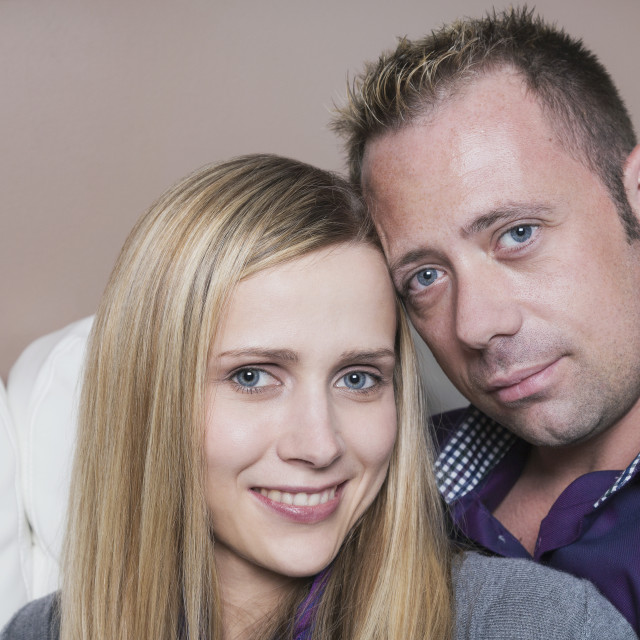 """""""Married couple cuddling on the couch, wife has a spinal cord injury and is a..."""" stock image"""