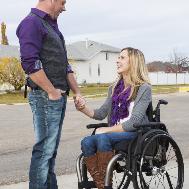 """""""Husband and wife with disability spending time together outdoors; Spruce..."""" stock image"""