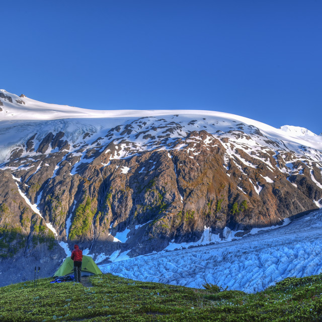 """""""A man camping near Exit Glacier on the Harding Ice Field Trail in Kenai..."""" stock image"""