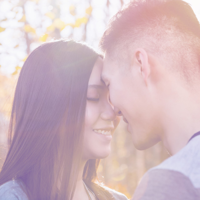 """""""A young Asian couple enjoying quality time together outdoors in a park in..."""" stock image"""