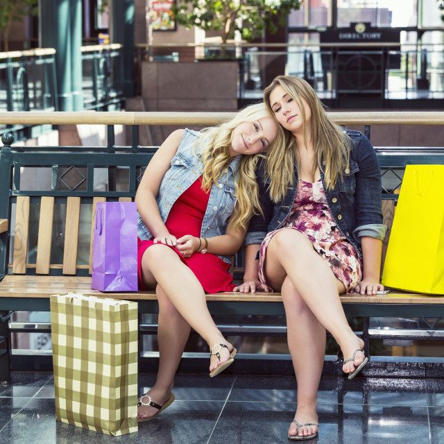 """""""Two beautiful young women taking a break while out shopping together and..."""" stock image"""