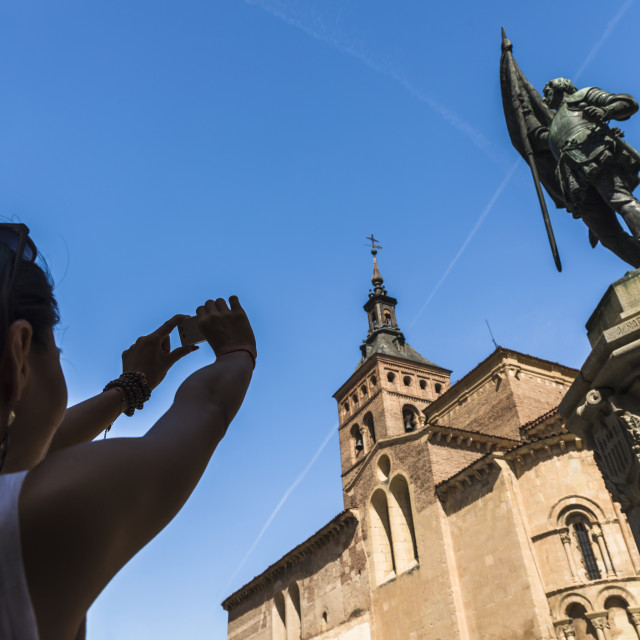 """""""An asian young woman taking a picture of San Martin Church and Juan Bravo..."""" stock image"""