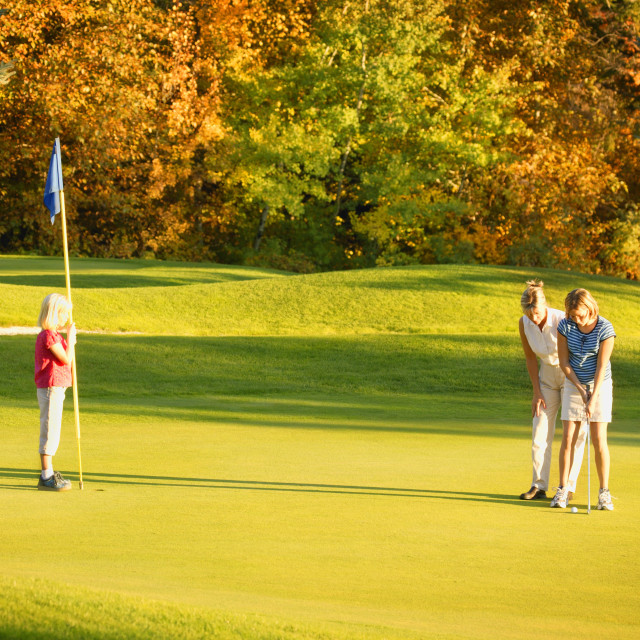 """""""Mother Teaches Daughter To Putt"""" stock image"""