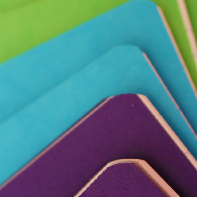 """Notebooks piled"" stock image"