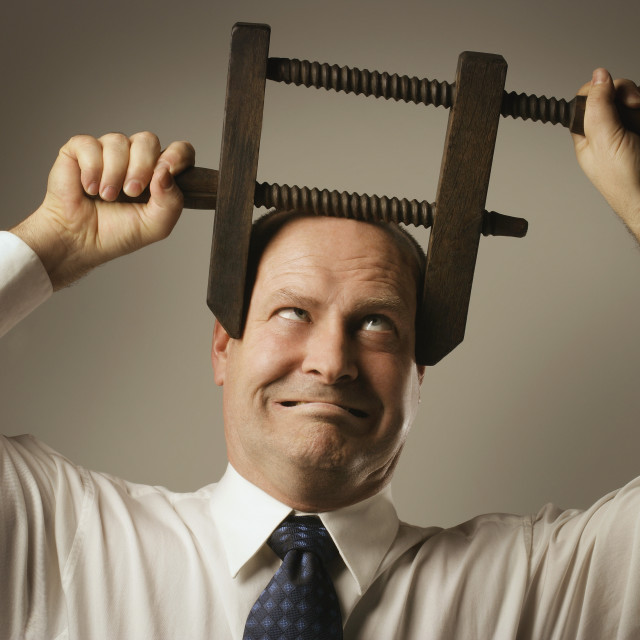 """""""Man With Head In Vice"""" stock image"""