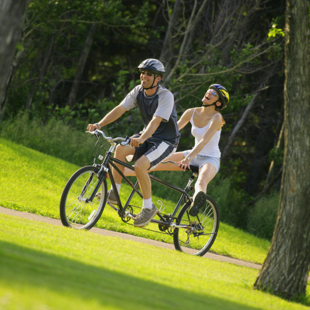 """Happy Couple On A Tandem Bike"" stock image"