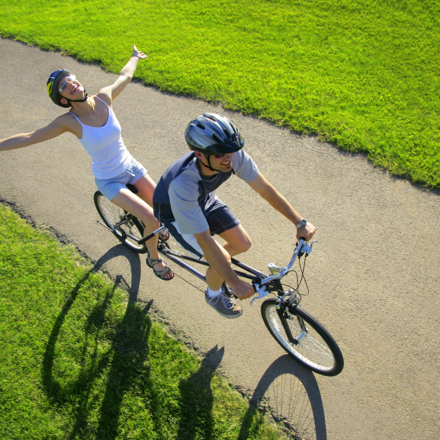 """Couple Riding A Tandem"" stock image"