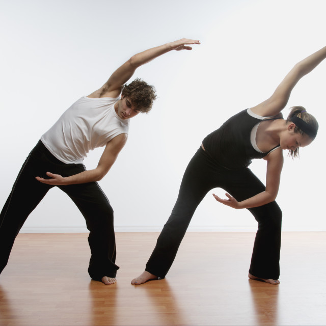 """""""Couple Stretching Together"""" stock image"""