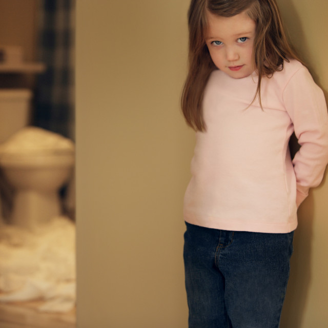 """""""Child Feeling Guilty For Toilet Paper Mess"""" stock image"""