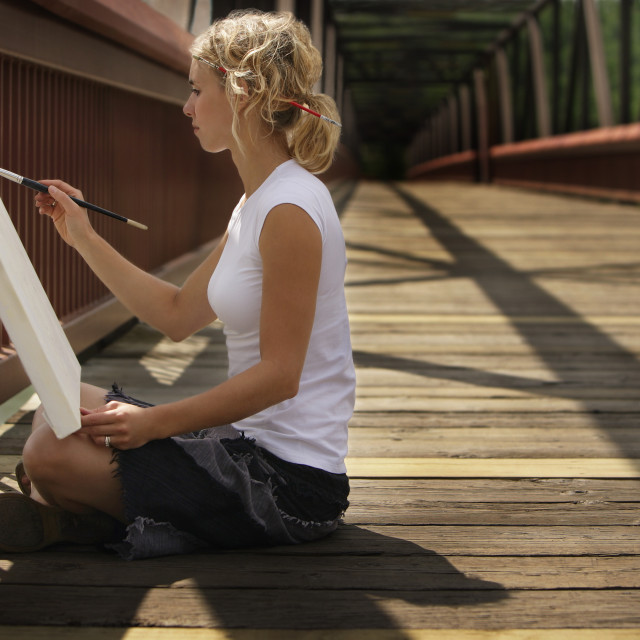 """Young Artist Painting On A Bridge"" stock image"