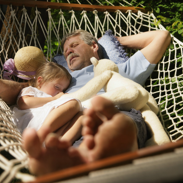 """Grandfather And Granddaughter Taking A Nap"" stock image"