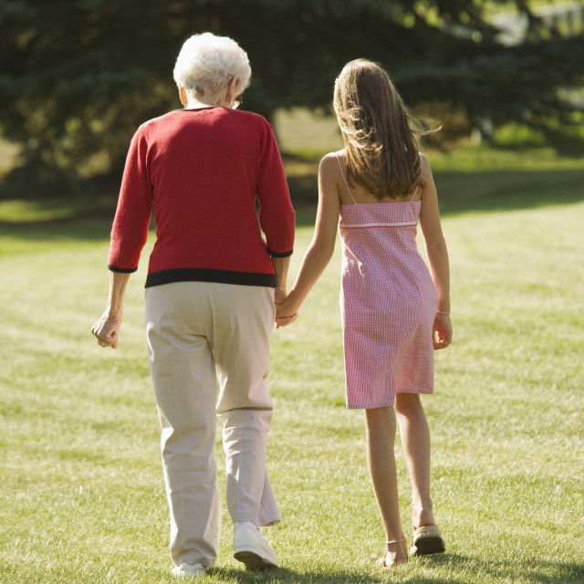 """Grandmother And Granddaughter Holding Hands"" stock image"