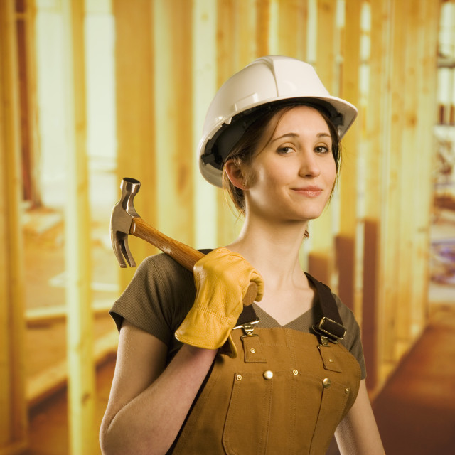 """""""A Woman Smiling And Holding A Hammer"""" stock image"""