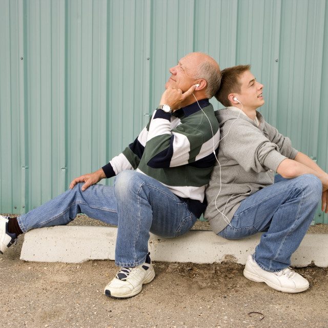 """Grandfather And Grandson Listening To Music"" stock image"