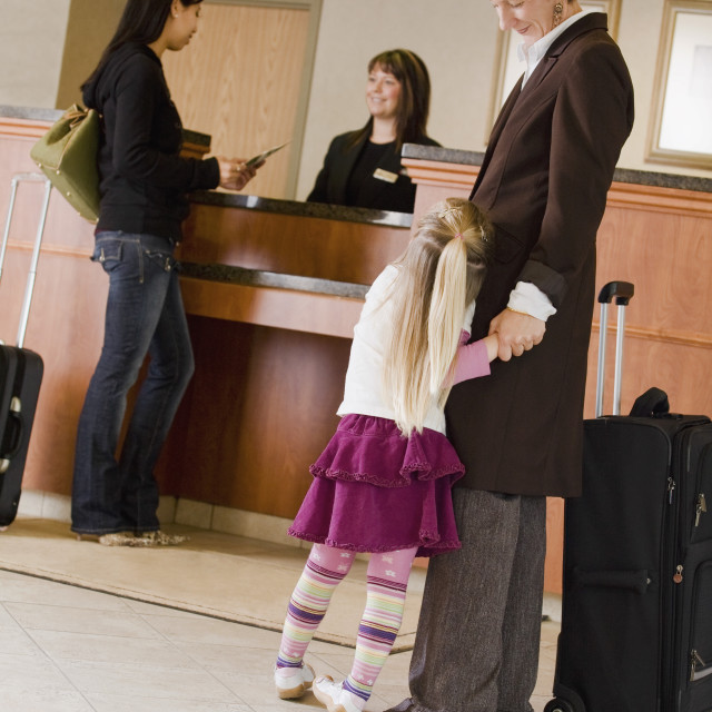 """Woman And Child In Hotel Lobby"" stock image"