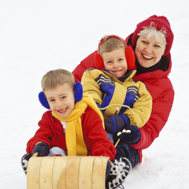 """Grandma And Grandsons Tobogganing"" stock image"