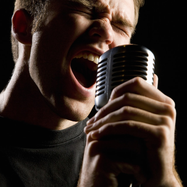 """""""Man Singing In A Microphone"""" stock image"""