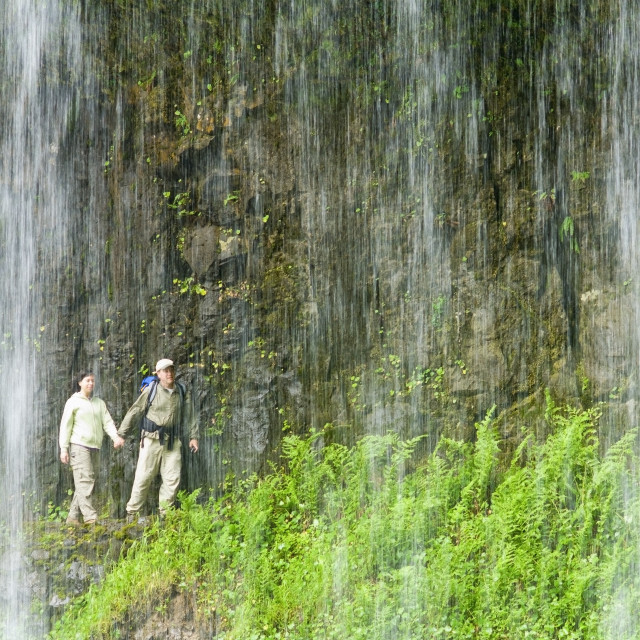 """""""Silver Falls State Park Oregon Usa; Hikers Behind Middle North Falls"""" stock image"""