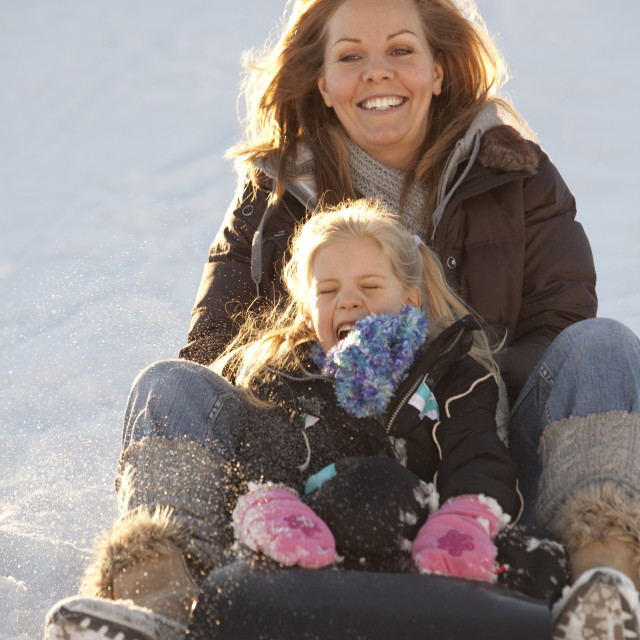"""""""Mother And Daughter Tobogganing"""" stock image"""