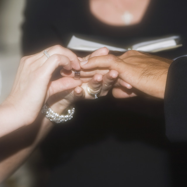 """""""Bride And Groom Exchanging Rings"""" stock image"""