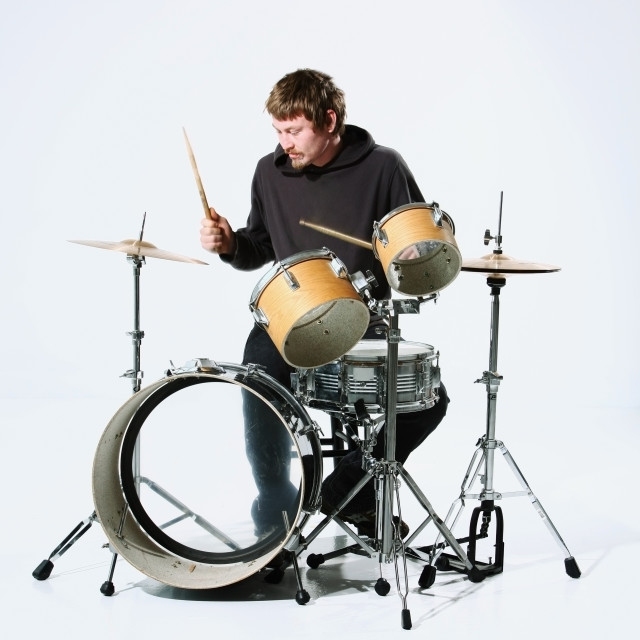 """A Young Man Playing The Drums"" stock image"