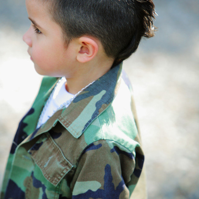 """""""A Young Boy With A Mohawk Wearing Camouflage; Oregon, Usa"""" stock image"""