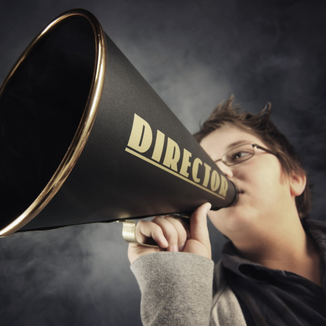 """A Boy With A Megaphone Labeled 'director'"" stock image"