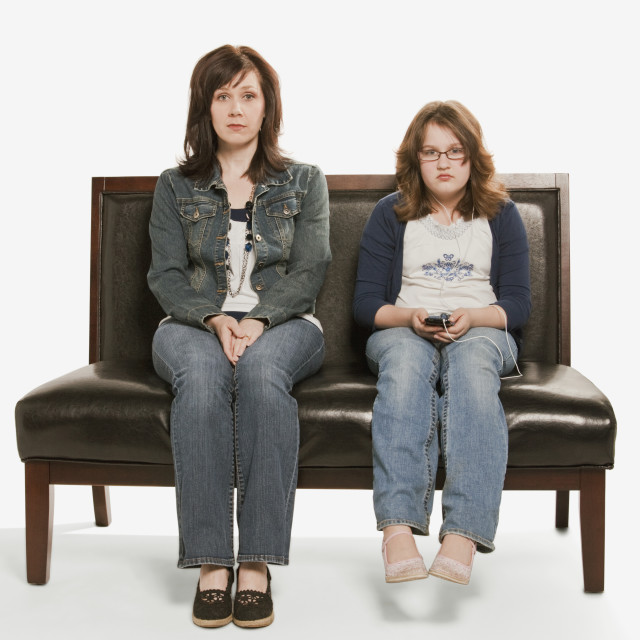 """""""Mother And Daughter Ignoring Each Other; Edmonton, Alberta, Canada"""" stock image"""