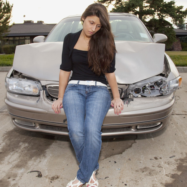 """Young Woman With Vehicle That Has Been In A Collision; Edmonton, Alberta, Canada"" stock image"