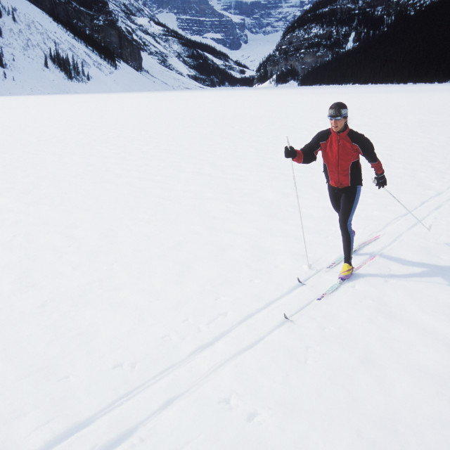 """""""Young Woman Cross Country Skiing On Lake Louise, Banff National Park,..."""" stock image"""