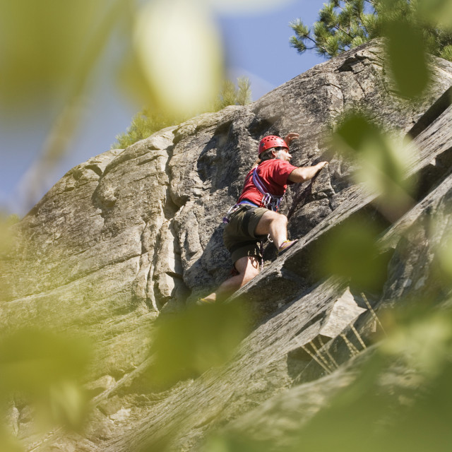 """""""Mid-Age Man Climbing Up 5.8 Route At Stone Hills Near Rexford, Montana, Usa"""" stock image"""
