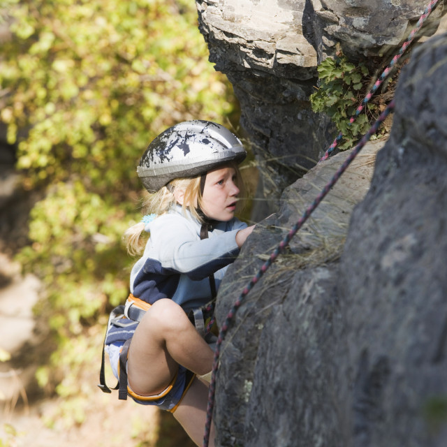 """""""Young Girl (Age 7) Climbing On Granite Cliff At Stone Hills Near Rexford,..."""" stock image"""